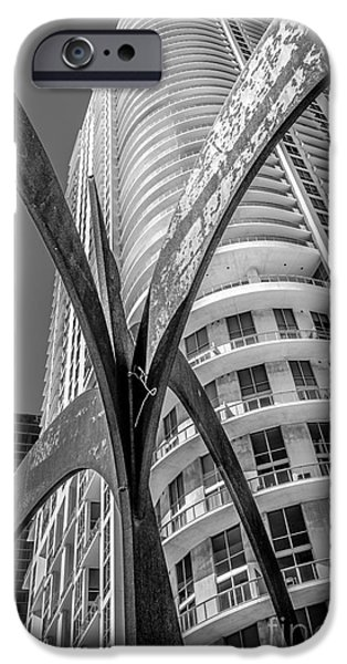 Concrete Jungle iPhone Cases - Element of Duenos do los Estrellas statue with Miami downtown in background - Black and White iPhone Case by Ian Monk