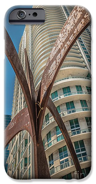 Statue Portrait iPhone Cases - Element of Duenos do los Estrellas statue with Miami downtown in background  iPhone Case by Ian Monk
