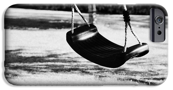 Missing Child iPhone Cases - Empty Plastic Swing Swinging In A Garden In The Evening iPhone Case by Joe Fox