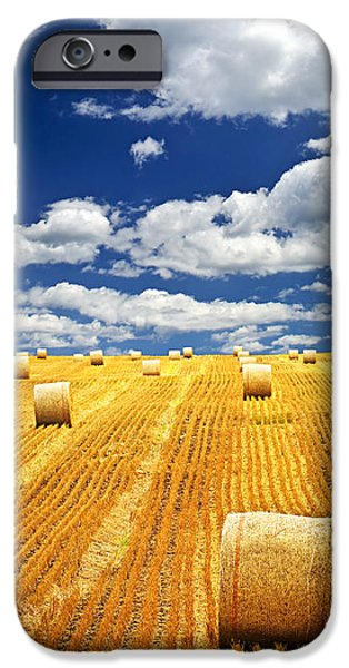 Field. Cloud iPhone Cases - Farm field with hay bales in Saskatchewan iPhone Case by Elena Elisseeva