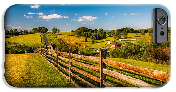Old Barns Pastels iPhone Cases - Fence and view of rolling hills and farmland in Antietam National Battlefield MD iPhone Case by Jon Bilous