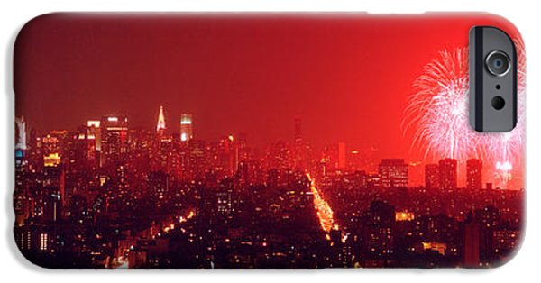 Fireworks iPhone Cases - Fireworks Display At Night Over A City iPhone Case by Panoramic Images