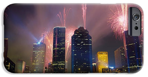 Fireworks iPhone Cases - Fireworks Over Buildings In A City iPhone Case by Panoramic Images
