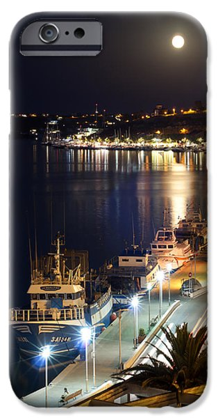 Night Lamp iPhone Cases - fishing boats under the august moonlight of Port Mahon in Menorca Island iPhone Case by Pedro Cardona