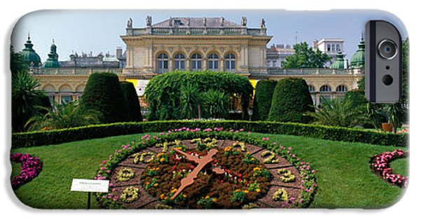 Floral Photographs iPhone Cases - Flower Clock, Stadtpark, Vienna, Austria iPhone Case by Panoramic Images