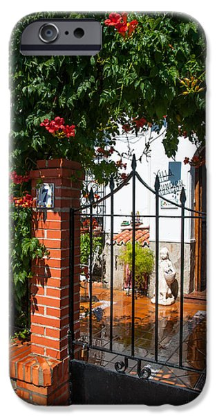 Spanish House iPhone Cases - Flowered Entrance. Ronda. Andalusia iPhone Case by Jenny Rainbow