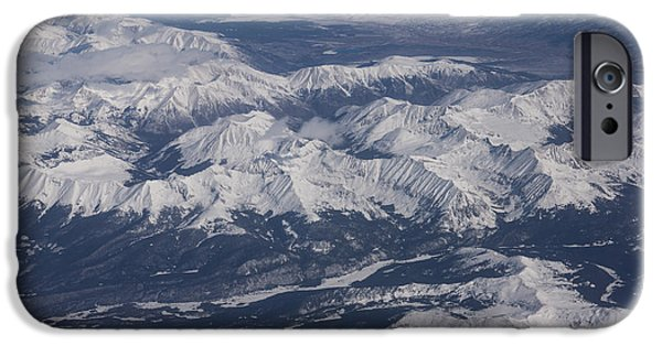 Freedom iPhone Cases - Flying Over the Snow Covered Rocky Mountains iPhone Case by Georgia Mizuleva