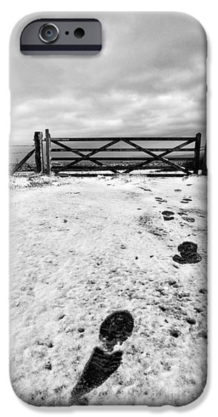 Drifting Snow Photographs iPhone Cases - Footprints in the snow iPhone Case by John Farnan