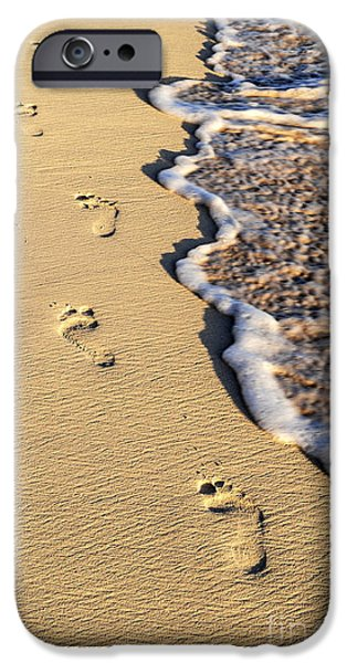Morning iPhone Cases - Footprints on beach iPhone Case by Elena Elisseeva