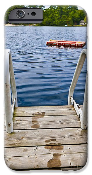 Wooden Platform iPhone Cases - Footprints on dock at summer lake iPhone Case by Elena Elisseeva