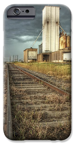 Turbulent Skies iPhone Cases - Foreboding Sky Above a Prairie Sentinel - Storm - Railroad Tracks iPhone Case by Jason Politte