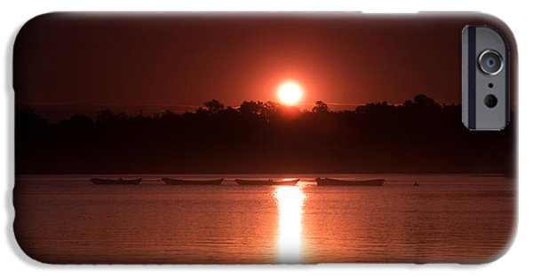 Canoe iPhone Cases - Four boats in a row under a red sun rising iPhone Case by Chris Bordeleau