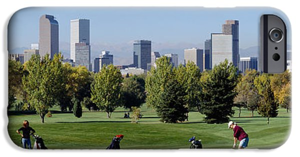 Tall Trees iPhone Cases - Four People Playing Golf With Buildings iPhone Case by Panoramic Images