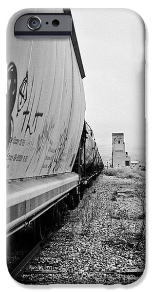 Sask iPhone Cases - freight grain trucks on canadian pacific railway through assiniboia Saskatchewan Canada iPhone Case by Joe Fox