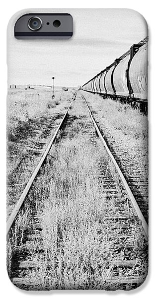 Sask iPhone Cases - freight grain trucks on former canadian pacific railway now great sandhills railway through leader S iPhone Case by Joe Fox