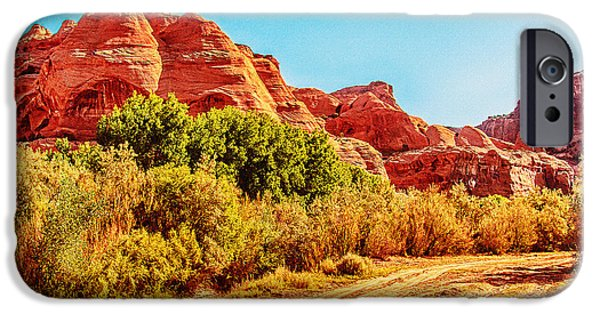 The View Mixed Media iPhone Cases - Getting the Sun in Canyon De Chelly iPhone Case by  Bob and Nadine Johnston