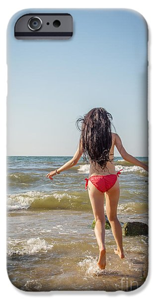 Surf Lifestyle Photographs iPhone Cases - Girl Jumping In Sea iPhone Case by Aleksey Tugolukov