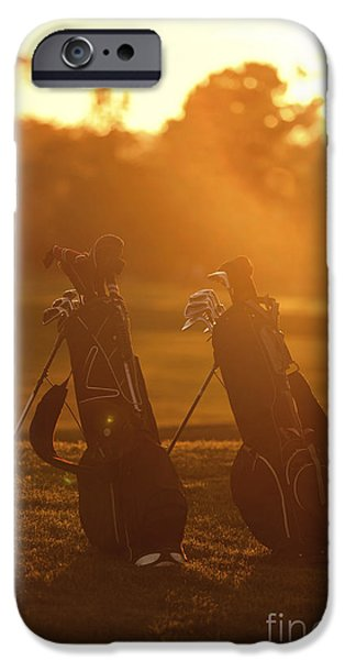 Golf Club iPhone Cases - Golf bags at sunset iPhone Case by Diane Diederich