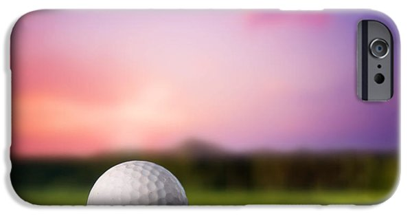 Golf Course iPhone Cases - Golf ball on tee at sunset iPhone Case by Michal Bednarek