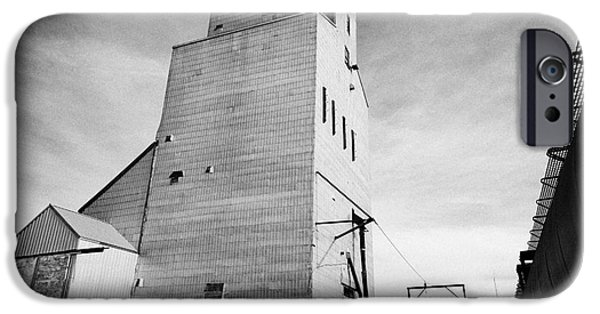 Sask iPhone Cases - grain elevator and old train track landmark leader Saskatchewan Canada iPhone Case by Joe Fox