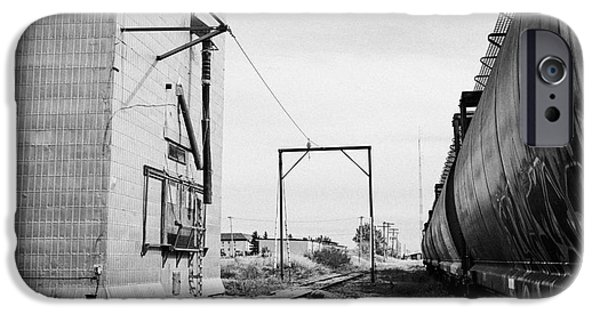 Sask iPhone Cases - grain elevator and old train track with grain railcars leader Saskatchewan Canada iPhone Case by Joe Fox