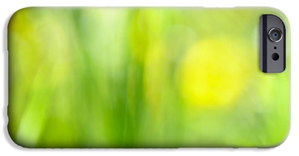 Freshness iPhone Cases - Green grass with yellow flowers abstract iPhone Case by Elena Elisseeva