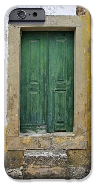 Green Wood Door with Hand Carved Stone against a Texured Wall in the Medieval Village Of Obidos iPhone Case by David Letts
