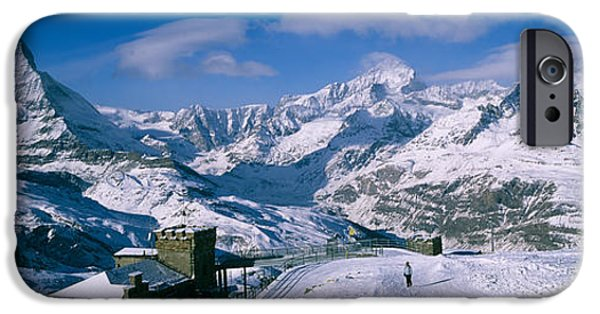 Winter Scene iPhone Cases - Group Of People Skiing Near A Mountain iPhone Case by Panoramic Images
