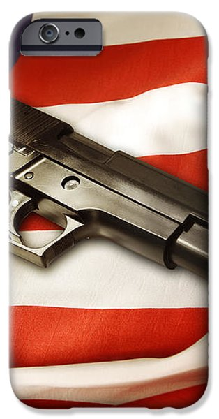 Gun on flag iPhone Case by Les Cunliffe