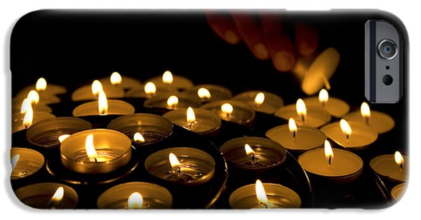 Close Up iPhone Cases - Hand lighting candles iPhone Case by Fabrizio Troiani