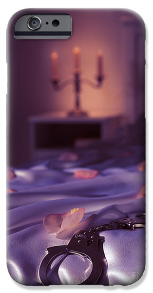 Suggestive Photographs iPhone Cases - Handcuffs and rose petals on bed iPhone Case by Oleksiy Maksymenko