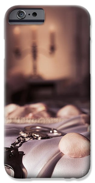 Suggestive Photographs iPhone Cases - Handcuffs ropes and rose petals on bed BDSM sex romantic concept iPhone Case by Oleksiy Maksymenko