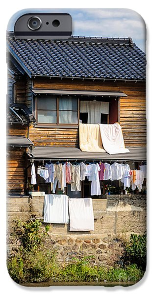 David iPhone Cases - Hanging out to dry - Laudry day in Japan iPhone Case by David Hill