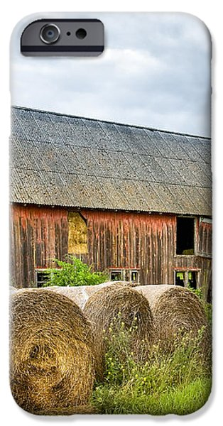 Hay bales and old barns iPhone Case by Gary Heller