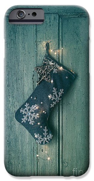 Celebration Photographs iPhone Cases - Holiday stocking with lights hanging on old door iPhone Case by Sandra Cunningham