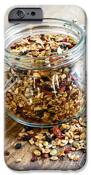 Berry iPhone Cases - Homemade granola in glass jar iPhone Case by Elena Elisseeva