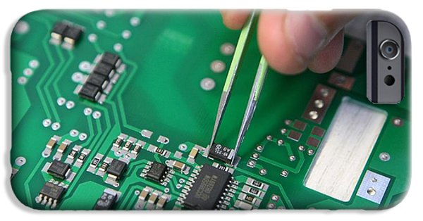 Electronic iPhone Cases - Installing Component On Circuit Board iPhone Case by Ria Novosti