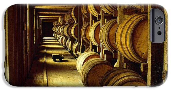 Daniel iPhone Cases - Jack Daniel whiskey maturing in barrels in old warehouse at the Lynchburg distillery Tennessee USA iPhone Case by David Lyons