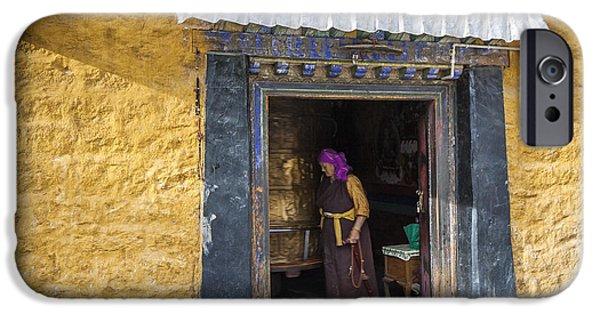 Tibetan Buddhism iPhone Cases - Lady and Prayer wheel  iPhone Case by Hitendra SINKAR