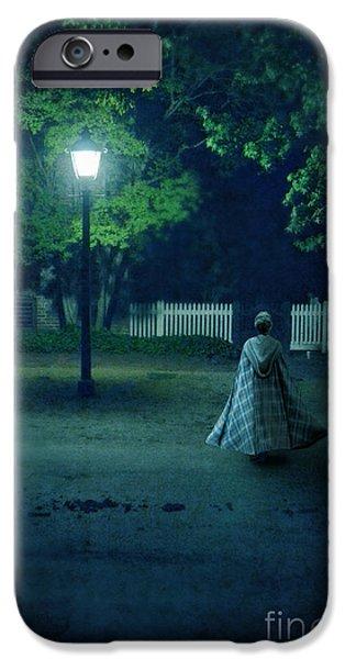 Lady in Vintage Clothing Walking by Lamplight iPhone Case by Jill Battaglia
