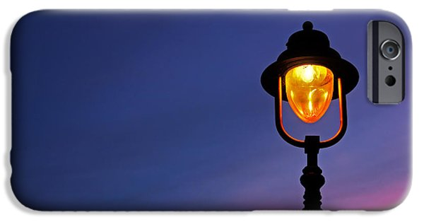 Night Lamp iPhone Cases - Lamppost Illuminated At Twilight iPhone Case by Mikel Martinez de Osaba