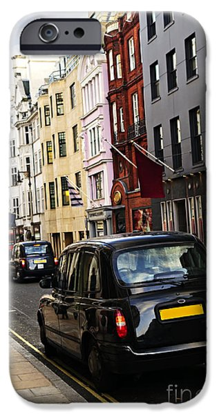 United iPhone Cases - London taxi on shopping street iPhone Case by Elena Elisseeva