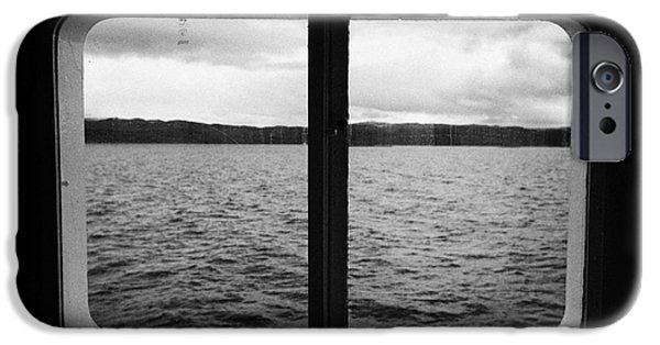 Cabin Window iPhone Cases - looking out of ships windows at the Beagle Channel and Isla Navarino Tierra Del Fuego Chile iPhone Case by Joe Fox