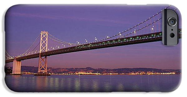 Oakland Bay Bridge iPhone Cases - Low Angle View Of A Bridge At Dusk iPhone Case by Panoramic Images