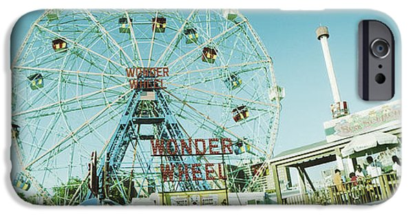 Built Structure iPhone Cases - Low Angle View Of A Ferris Wheel iPhone Case by Panoramic Images