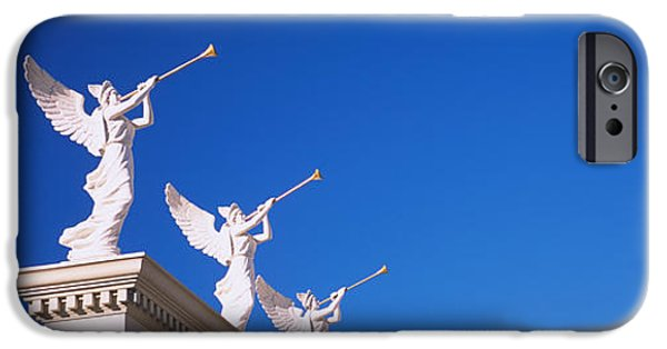 Angel Blues iPhone Cases - Low Angle View Of Statues On A Wall iPhone Case by Panoramic Images