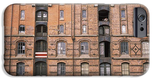 Repetition Photographs iPhone Cases - Low Angle View Of Warehouses In A City iPhone Case by Panoramic Images
