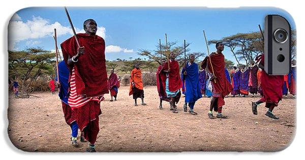 East Village iPhone Cases - Maasai men in their ritual dance in their village in Tanzania iPhone Case by Michal Bednarek