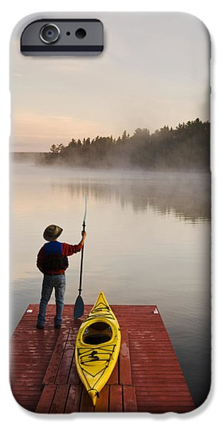Dave iPhone Cases - Man Standing By Kayak On Dock In iPhone Case by Dave Reede
