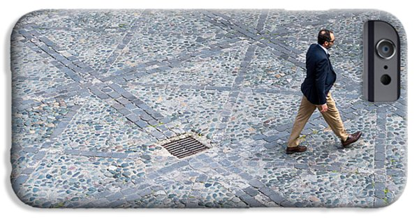 Ambition Photographs iPhone Cases - Man Walking on Cobblestones iPhone Case by Chay Bewley